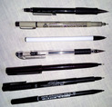 Various ink pens for sketching and drawing in pen and ink.
